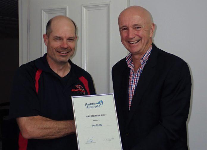 Ian Hume receiving his Life Membership award from Paddle Australia CEO Phil Jones